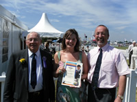 Katy Waller receives her travel scholarship from John Platt (left) and Meredydd David at the Cheshire Show